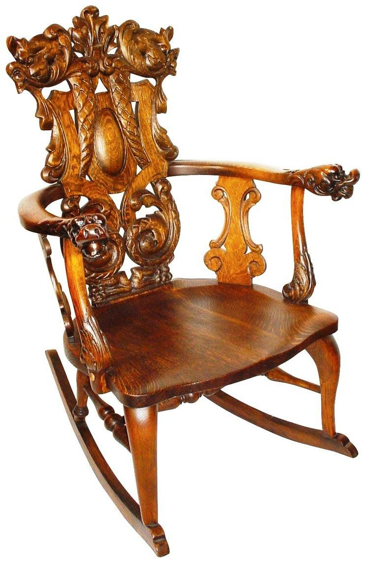 Gustav Stickley This ornately carved rocker is a Stickley but not Gustav Stickleys