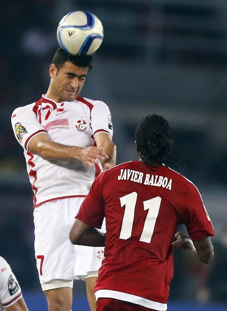 Hamza Mathlouthi Hamza Mathlouthi L of Tunisia fights for the ball with