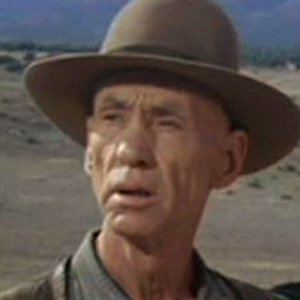 Hank Worden looking afar while wearing a hat