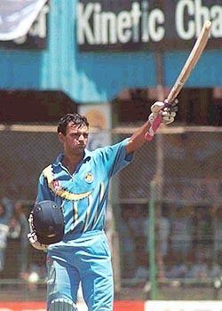 Hemang Badani raises his bat on reaching his hundred Photo