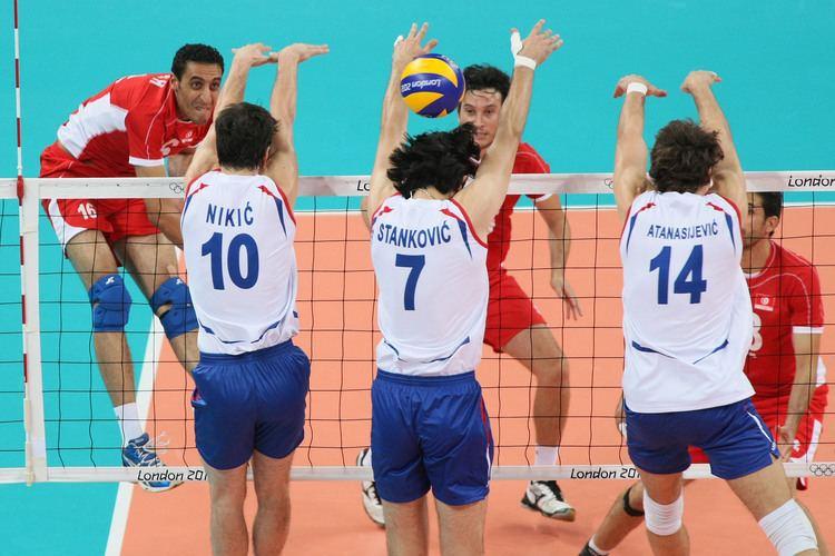 Hichem Kaabi Hichem Kaabi left of Tunisia spikes against Nikic Stankovic and