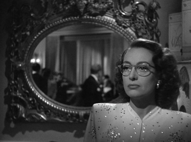 Humoresque (film) movie scenes In Humoresque she plays a rich socialite Helen Wright who fancies herself a patron of unknown artists and keeps a group of attractive sycophantic young