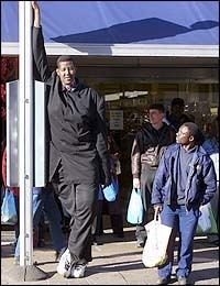 Hussain Bisad leaning on a pole while wearing a black long sleeves and black pants