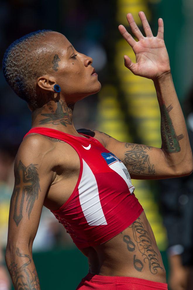 Inika McPherson what a feeling Lesbian Olympians Inika McPherson High Jump