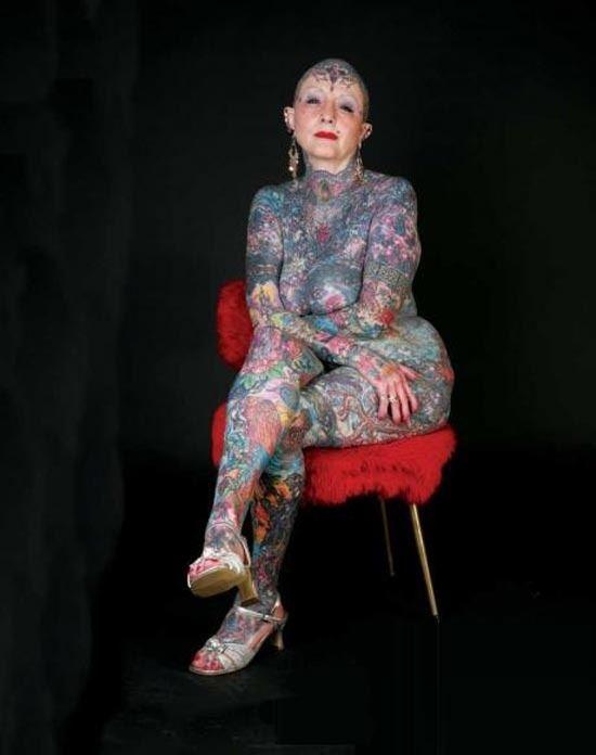 Nude woman most tattooed