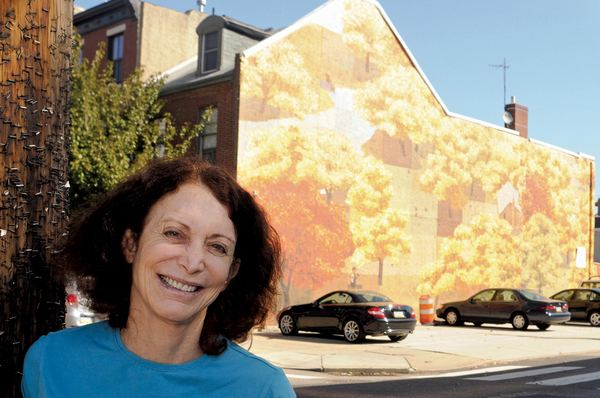 Jane Golden She uses paint brushes and volunteers to clean up graffiti and
