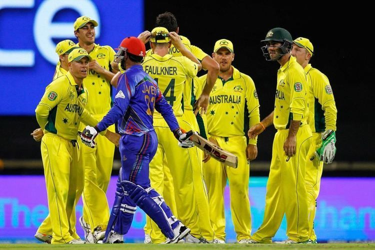 Australia celebrates after taking the wicket of Javed Ahmadi of