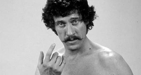 John Holmes (actor) on his captivating look wearing nothing on top