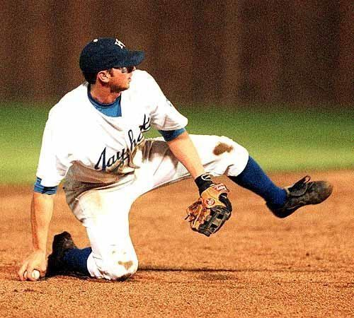 John Nelson (baseball) Photo Kansas University shortstop John Nelson looks to throw during
