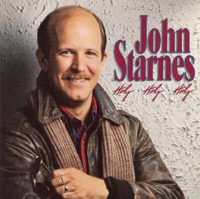 John Starnes wearing brown leather jacket with brown scarf