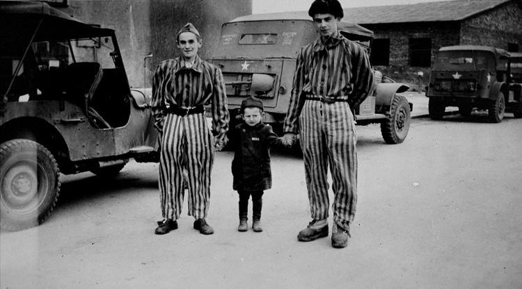 Joseph Schleifstein Child survivor Joseph Schleifstein center poses with two