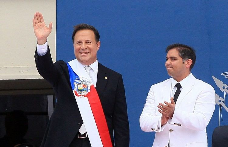 Juan Carlos Varela Chatting with Panamanian President and Yellow Jacket Juan Carlos