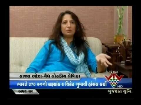 Kaajal Oza Vaidya featured in the news, wearing a blue dress with a blue scarf.