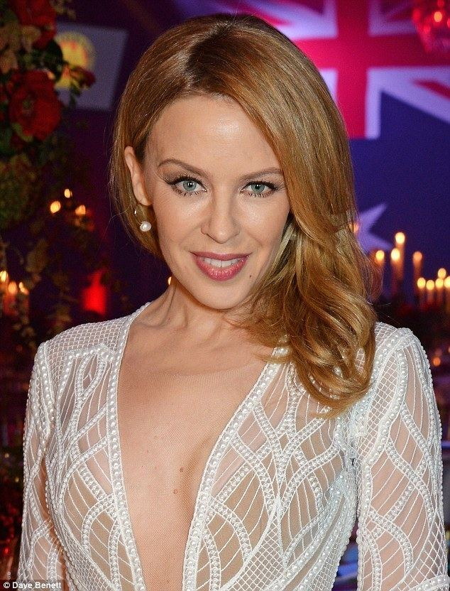 Kylie Minogue Kylie Minogue stuns in plunging semisheer gown as she is
