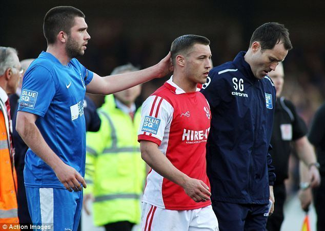 Lee Vaughan Kidderminster player PUNCHED by Stockport fan during pitch