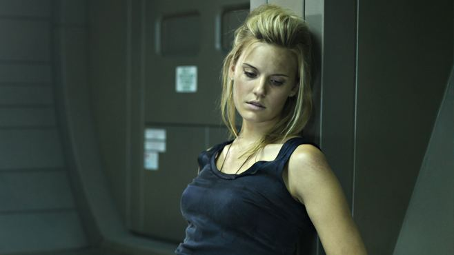 Lockout (film) movie scenes Seeing as someone as hot as Maggie Grace was sent to a space prison as part of her job it s safe to assume she pissed somebody off bad
