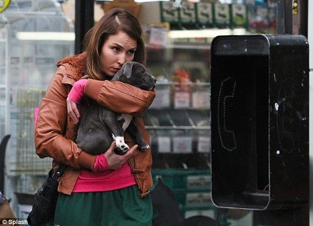 Love That Pup movie scenes Puppy love Noomi Rapace cuddled up to a small puppy as she shot scenes with