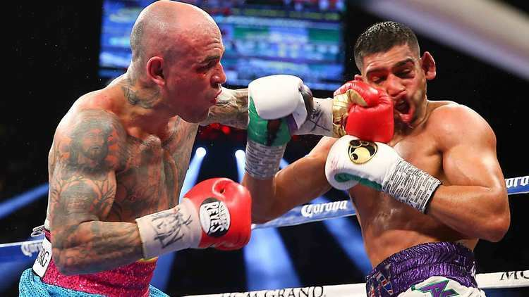 Luis Collazo Luis Collazo delivers knuckle sandwiches in the ring sandwich
