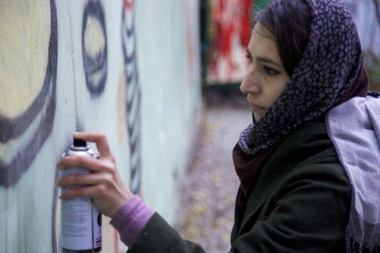 Malina Suliman Malina Suliman makes graffiti on walls of Kandahar