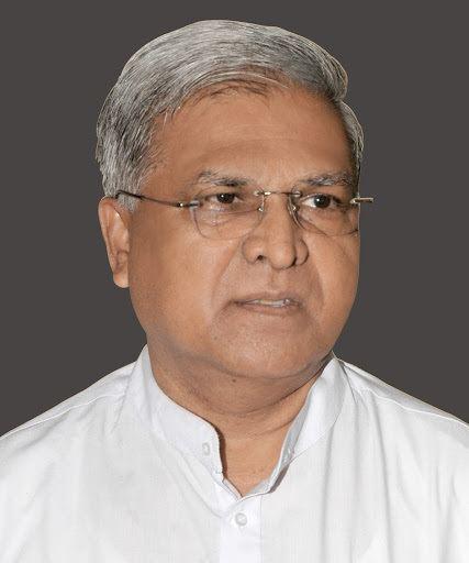 Mangubhai C. Patel looking at the side while wearing eyeglasses and white sleeve