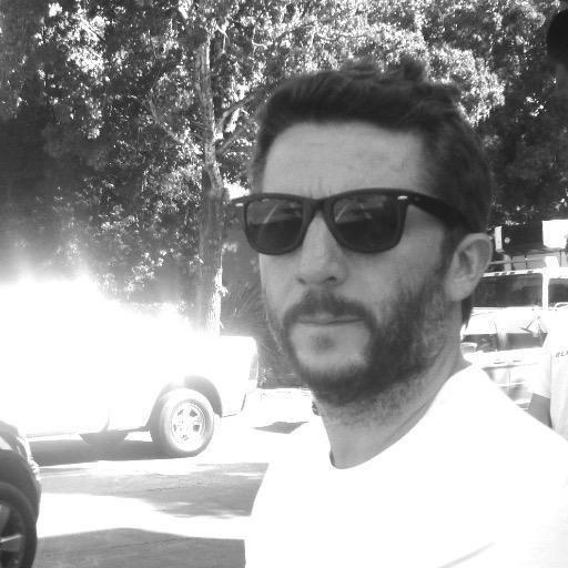 Mark Rankin wearing black shades and a white t-shirt