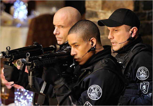 """Mark Taylor (playing Lewis Young) aiming their gun along with Enrico and Hugh in a movie scene from """"Flashpoint, 2008"""""""