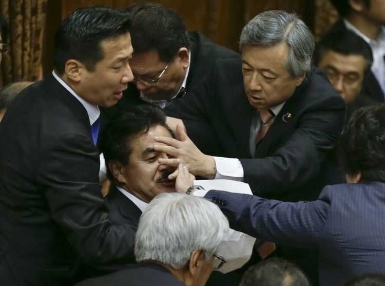 Masahisa Sato Photos Japan39s lawmakers have a fistfight over pacifism