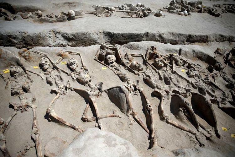 Mass grave Skeletons shackled at the wrists found in ancient mass grave in