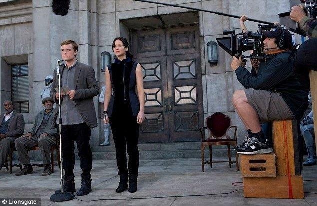 Mickeys Fire Brigade movie scenes And action Jennifer Lawrence and Josh Hutcherson being shot as Katniss Everdeen and Peeta Mellark
