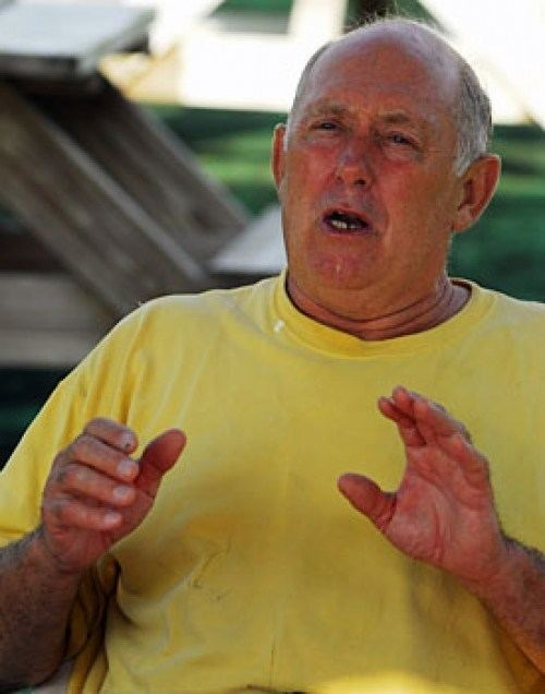 Mike Marshall (pitcher) doing hand gestures wearing a plain yellow shirt during an interview
