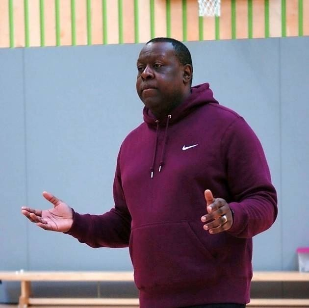Mike McFarlane Olympic athlete Mike McFarlane puts Ilford pupils through their