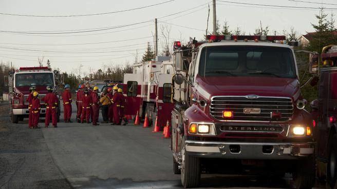 Mindville movie scenes Firefighters attend the scene of a brush fire near Shoreline Drive in Mineville on Thursday