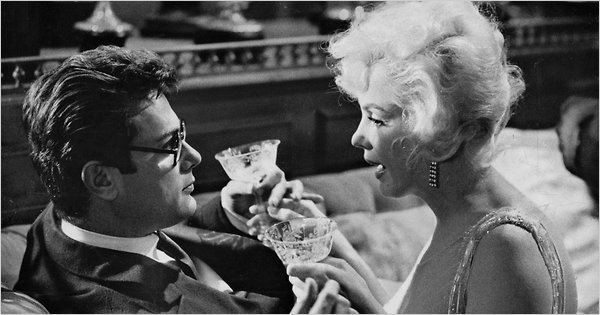 Modern Inventions movie scenes Tony Curtis doing his best Cary Grant imitation with Marilyn Monroe in a scene from Some Like It Hot 1959 Credit United Artists