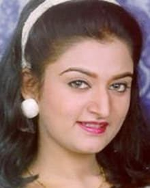 Mohini with a smiling face, wearing a white headband, white earrings, and a necklace.