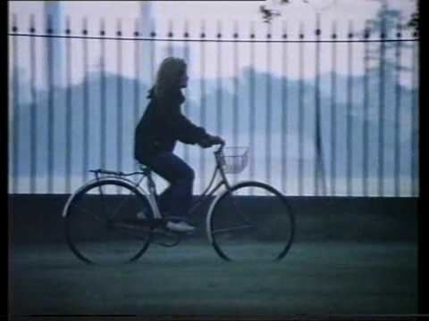 Monkey Grip (film) 1981 Noni Hazlehurst Riding Along Princes Park in the great Oz movie