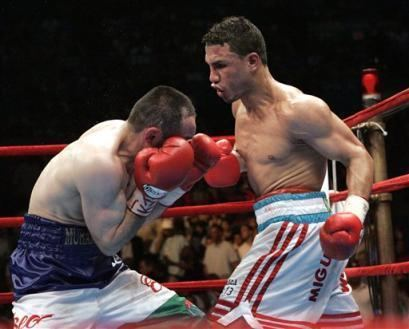 Muhammad Abdullaev Photos Miguel Cotto right of Puerto Rico hits Muhammad