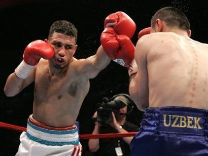 Muhammad Abdullaev Photos Miguel Cotto left of Puerto Rico hits Muhammad Abdullaev
