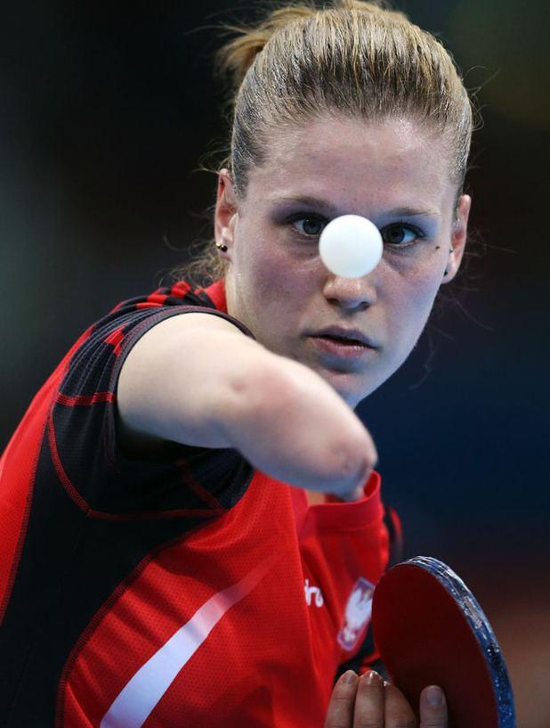 Natalia Partyka Natalia Partyka of Poland serves against Li Jie of the
