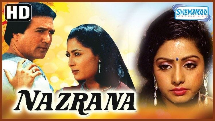 The movie poster of Nazrana (1987 film) with Rajesh Khanna, and Sridevi, with the scene of Smita Patil on the left
