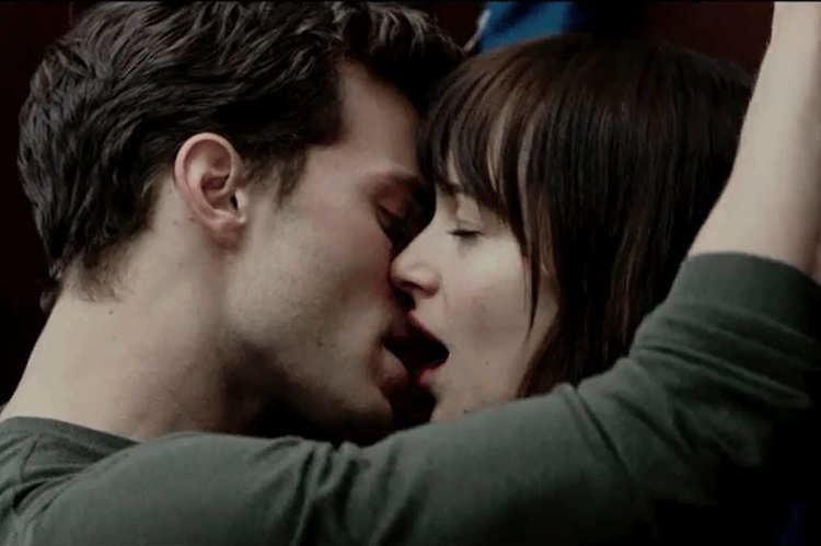 Neck (film) movie scenes Jamie Dornan and Dakota Johnson in Fifty Shades of Grey Photo Focus Features