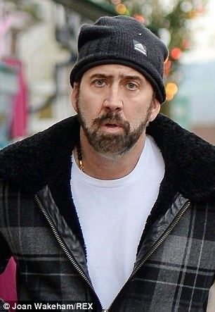 Nicolas Cage Bearded Nicolas Cage is almost unrecognisable as he and son KalEl