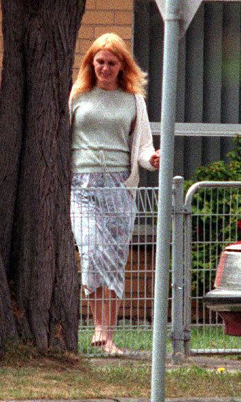 Nicole Louise Pearce with blonde hair, wearing a white sweatshirt, mint green shirt, and a skirt.