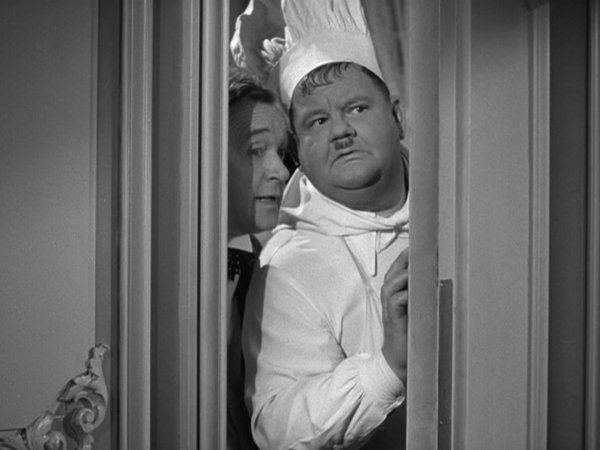 Nothing but Trouble (1944 film) movie scenes Mr Mrs Hawkley and their V I P guest Prince Saul are seated and ready to receive their starter meal soup Stan clumsily gets everything wrong and is