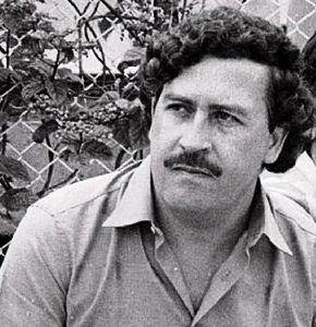 Pablo Emilio Escobar Gaviria with a mustache and curly hair.