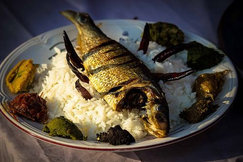 Panta bhat A traditional platter of Panta bhat with fried Ilish slice a