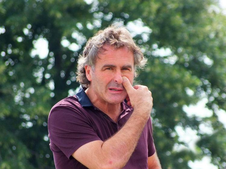 Paul Martin wearing a purple polo shirt.