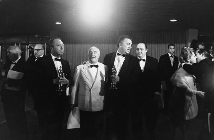 Piero Gherardi Piero Gherardi costume designer and Federico Fellini holding the