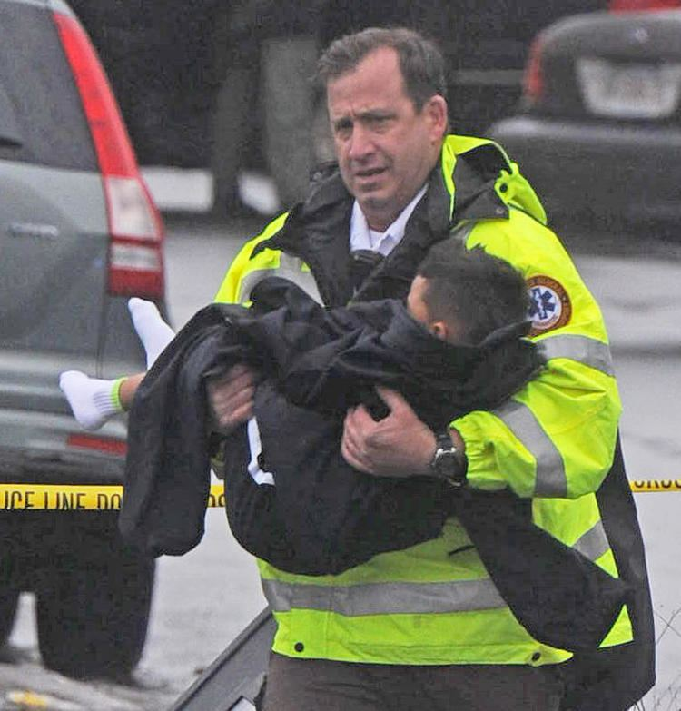 Police Rescue Lawrence police rescue boy after barricaded gunman wounds girlfriend