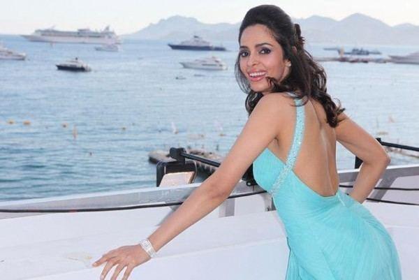 Politics of Love Mallika promotes her movie Politics of Love at Cannes