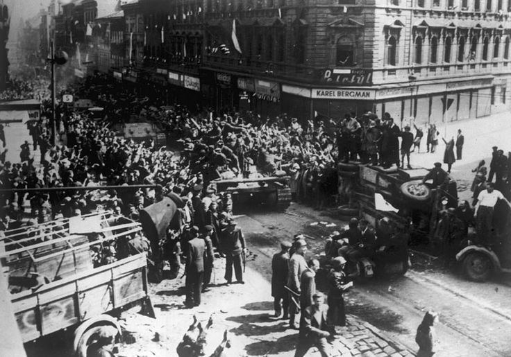 Prague Offensive Residents and fighters of Prague Uprising greet Soviet tanks and